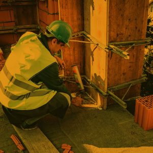 A caulker repairs an existing structure