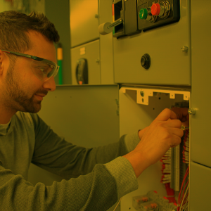 Inside electrician working on a control panel