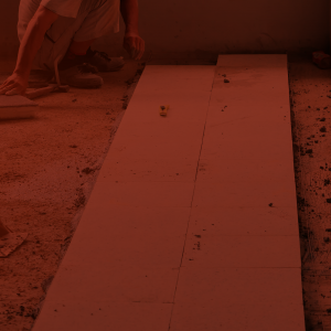 Terrazzo worker laying out a terrazzo floor